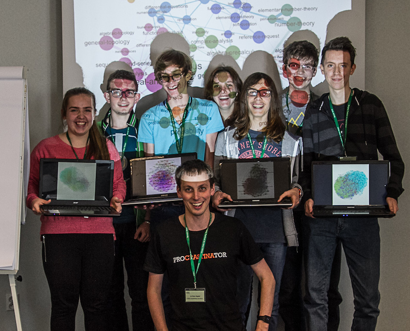 "After ""complex networks are simple"" workshop on the multidisciplinary camp in 2015. Participants hold their graph visualization of Facebook networks, in Gephi."