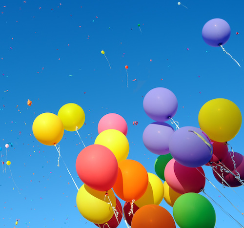 multicolored balloons and confetti
